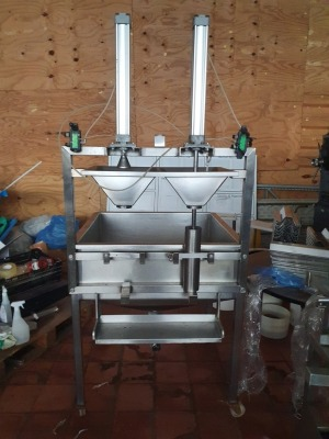 Mobile Stainless Steel Hopper with Twin Head Manual Filling Tubes and Presses